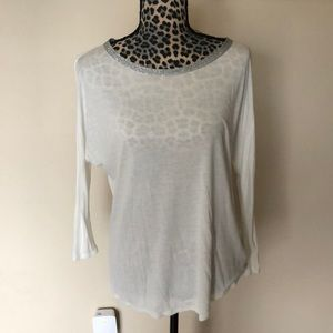 Sparkly neck lined shirt.